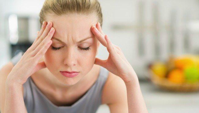 woman at home pounding headache