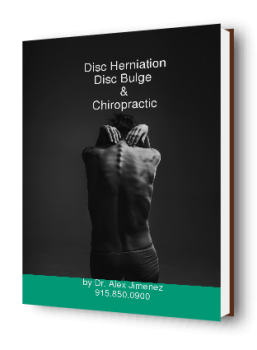 blog picture of woman touching her back with possible disc herniation or bulge and how chiropractic can help