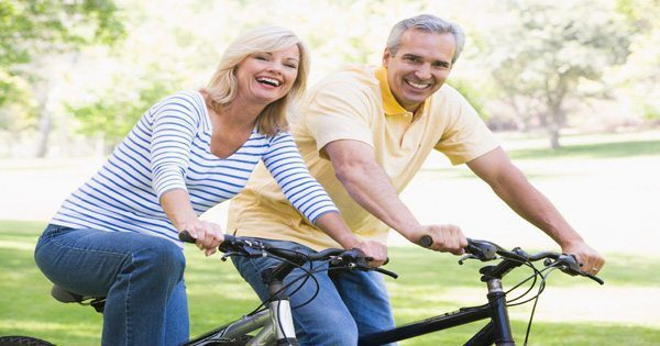 blog picture of elderly couple riding bicycles
