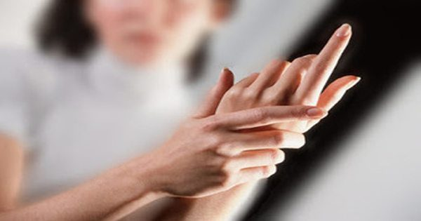 blog picture of lady grabbing her hand in pain