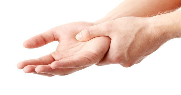 blog picture of man grabbing hand in pain