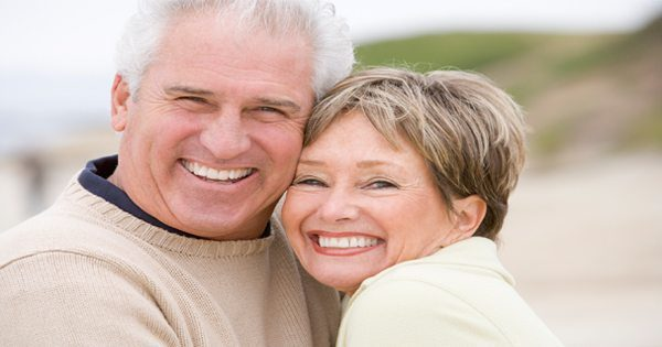 blog picture of elderly couple hugging and smiling