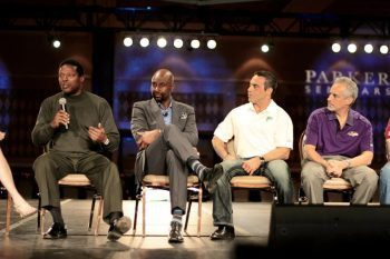 blog picture of legendary football player on stage having a discussion