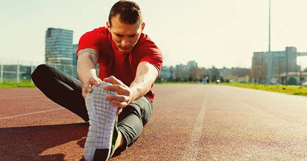 blog picture of runner on track stretching leg