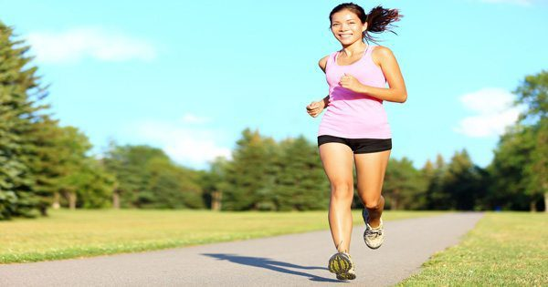 blog picture of young female jogging on park path