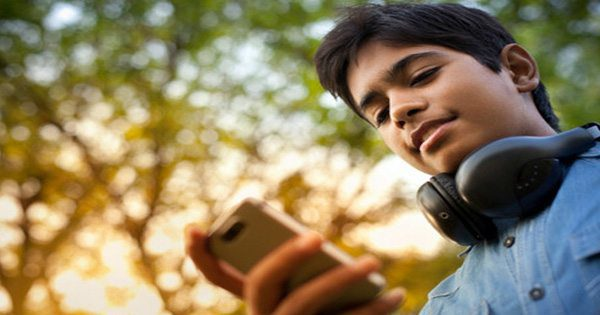 blog picture of teenage boy looking down at phone texting