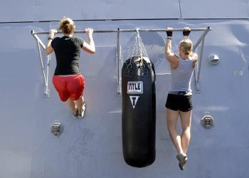 blog picture of two ladies doing pull ups side by side