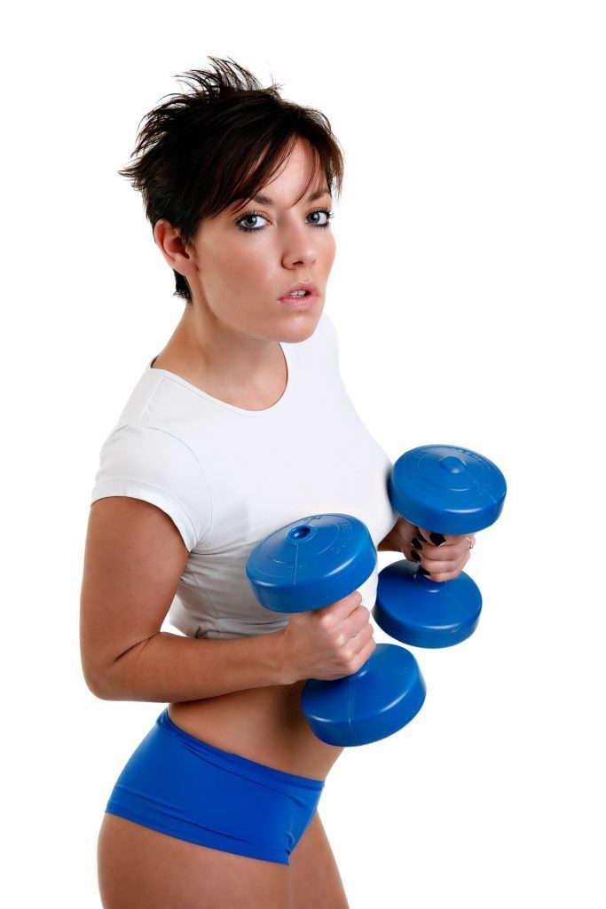 blog picture of lady working out with dumbells