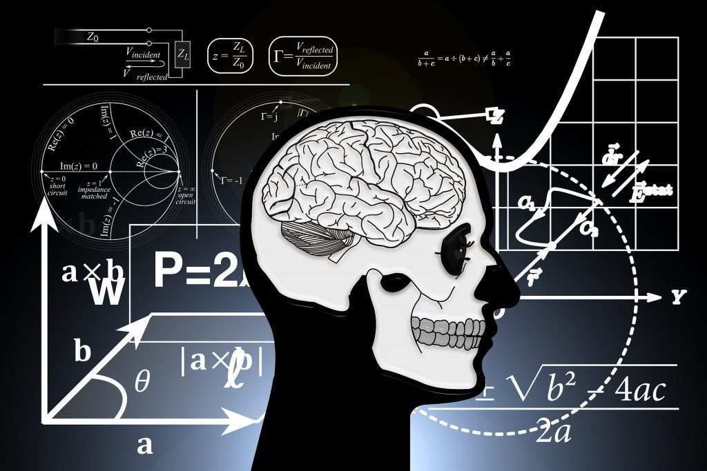 blog illustration of human brain in front of board with mathematical equations around it
