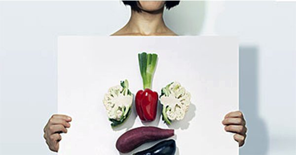 blog picture of lady holding a board with vegetables