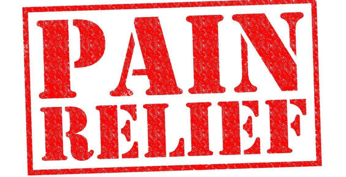 stock photo sello de goma de alivio de dolor rojo sobre un fondo blanco