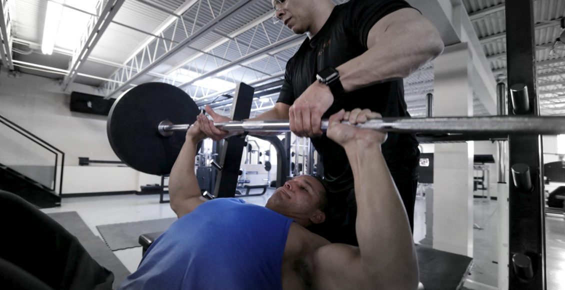 daniel doing bench press & dr. jimenez spots
