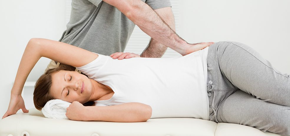 chiropractor works on patient