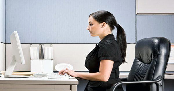 Lady sitting with proper posture at office desk