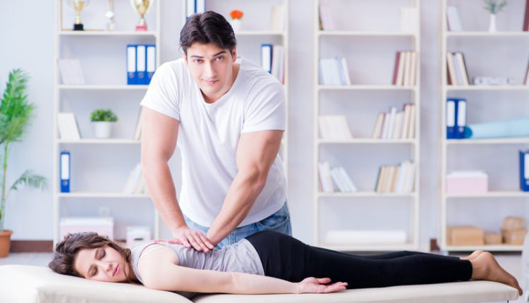 chiropractor works on woman's spine