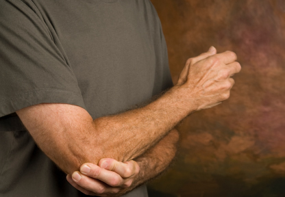 tennis elbow man grabbing elbow