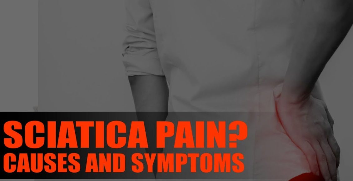 Image of a person holding their back due to sciatica.