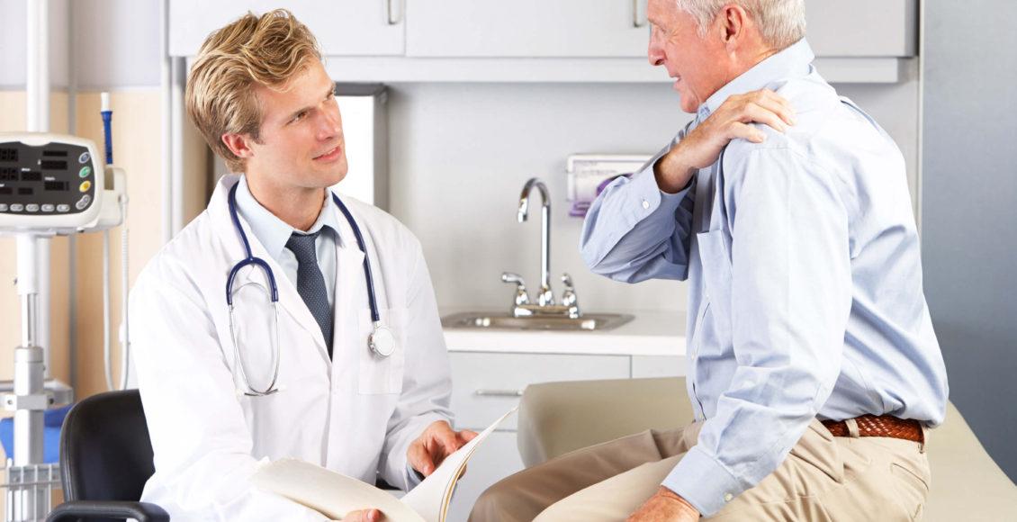 Older male patient visits healthcare professional for shoulder pain.