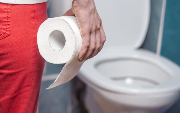 woman-is-holding-toilet-paper-concept-diarrhea-constipation_8119-1107